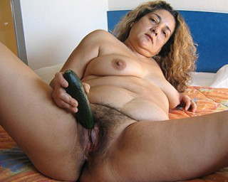 Hairy mature mama playing with herself